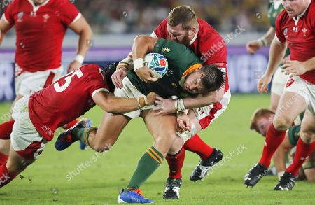 Handre Pollard (C) of South Africa is tackled by Welsh players Jake Ball (R) and Leigh Halfpenny (L) during the Rugby World Cup 2019 semi final match between South Africa and Wales at the International Stadium Yokohama in Yokohama City, Japan, 27 October 2019.