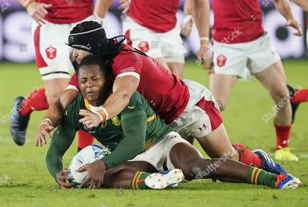 S'busiso Nkosi (L) of South Africa is tackled by Leigh Halfpenny (R) of Wales during the Rugby World Cup 2019 semi final match between South Africa and Wales at the International Stadium Yokohama in Yokohama City, Japan, 27 October 2019.