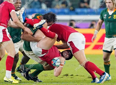 Eben Etzebeth (C-L) of South Africa tackles Leigh Halfpenny (C) of Wales during the Rugby World Cup 2019 semi final match between South Africa and Wales at the International Stadium Yokohama in Yokohama City, Japan, 27 October 2019.