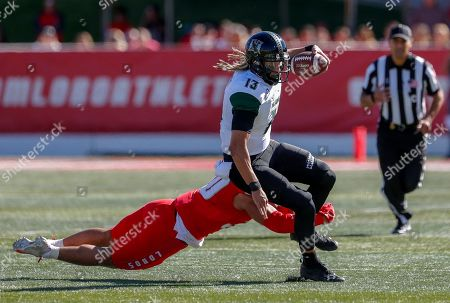 Cole McDonald, Alexander Vainikolo. Hawaii quarterback Cole McDonald (13) is tackled by New Mexico linebacker Alexander Vainikolo (30) during the first half of an NCAA college football game on in Albuquerque, N.M