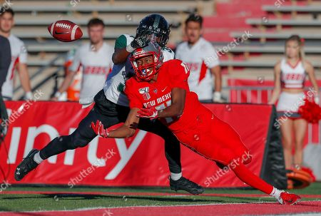 Stock Picture of Cedric Patterson, James Green. New Mexico wide receiver Cedric Patterson (11) attempts to catch the ball in the end zone against Hawaii defensive back James Green (34) during the second half of an NCAA college football game, in Albuquerque, N.M