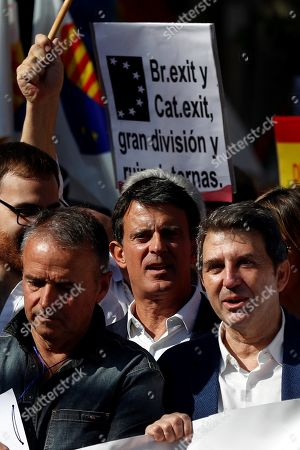 Manuel Valls (C), Barcelona City Hall's councillor and former French Prime Minister, attends a rally against Catalan pro-independent process in downtown Barcelona, Catalonia, Spain, 27 October 2019. About thousand of demonstrators took part in the rally which was organized by the pro-Spain Catalan group Societat Civil Catalana (Catalan Civil Society).