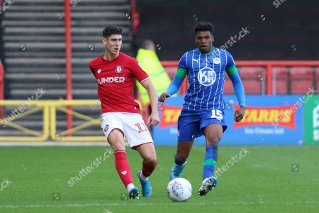 Bristol City's Callum O'Dowda and Dujon Sterling (15) of Wigan Athletic during the EFL Sky Bet Championship match between Bristol City and Wigan Athletic at Ashton Gate, Bristol