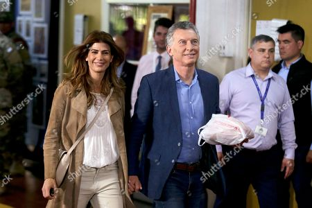 President Mauricio Macri arrives, with his wife Juliana Awada, to vote in Buenos Aires, Argentina, . Argentina could take a political turn in Sunday's presidential elections, with center-left Peronist candidate Alberto Fernandez favored to oust Macri amid growing frustration over the country's economic crisis