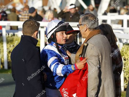 Stock Photo of Bryony Frost talks with owner Paul Vogt after Frodon is beaten at Aintree.