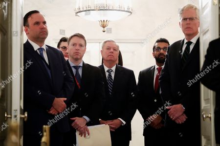 """Lindsey Graham, Dan Scavino, Kashyap """"Kash"""" Pramod Patel, Kash Pramod Patel, Chris Miller. Sen. Lindsey Graham, R-S.C., center, listens as President Donald Trump speaks in the Diplomatic Room of the White House in Washington, to announce that Islamic State group leader Abu Bakr al-Baghdadi has been killed during a U.S. raid in Syria. White House Social Media Director Dan Scavino, far left, National Security Council Senior Director of Counterterrorism Kashyap """"Kash"""" Pramod Patel, second from right, and National Security Council Senior Director for Counterterrorism and Threat Networks Chris Miller, right, stand by Graham"""