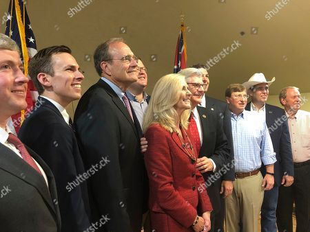 Mississippi Republican nominees for statewide offices pose with Gov. Phil Bryant, fifth right, and state GOP chairman Lucien Smith, fourth left, at a campaign event in Madison, Miss. Pictured from left are treasurer nominee David McRae; Auditor Shad White; Secretary of State Delbert Hosemann, who is running for lieutenant governor; Smith in back row; Treasurer Lynn Fitch, who is running for attorney general; Bryant; state Sen. Michael Watson, who is running for secretary of state; Lt. Gov. Tate Reeves, who is running for governor; Agriculture Commissioner Andy Gipson; and Insurance Commisioner Mike Chaney. Bryant is term-limited. Republican nominees for statewide offices in Mississippi appeared at a campaign rally in September, making speeches about unity and posing for smiling group photos. Democrats have not done the same, and there are no signs that they'll do so before the Nov. 5 election for governor and other positions
