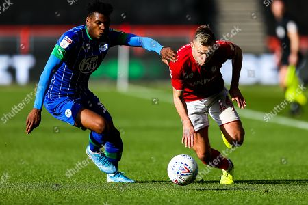 Andi Weimann of Bristol City is challenged by Dujon Sterling of Wigan Athletic