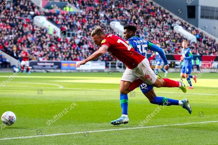 Stock Image of Andi Weimann of Bristol City is challenged by Dujon Sterling of Wigan Athletic