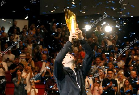 Stock Picture of Dominic Thiem of Austria poses with the trophy amidst a shower of confetti after winning the final match against Diego Schwartzman of Argentina during their final match at the Erste Bank Open tennis tournament in Vienna, Austria