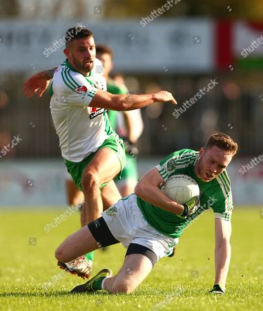 Stock Photo of Moorefield vs Sarsfields. James Murray of Moorefield with Matty Byrne of Sarsfields.