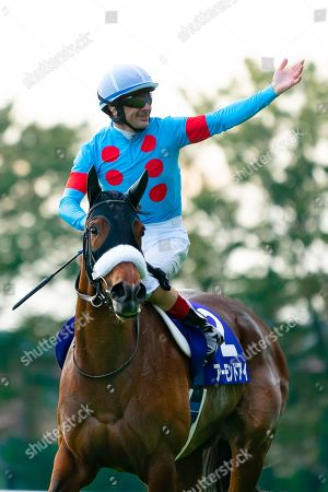 Almond Eye ridden by French jockey Christophe Lemaire, wins the Tenno-Sho