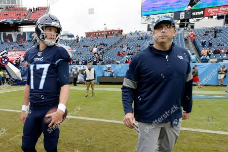 Tennessee Titans quarterback Ryan Tannehill (17) talks with offensive coordinator Arthur Smith before an NFL football game against the Tampa Bay Buccaneers, in Nashville, Tenn