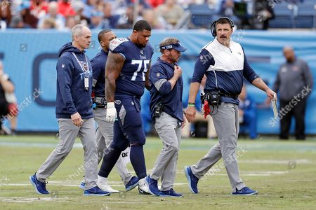 Tennessee Titans offensive guard Rodger Saffold (76) leaves the field after being shaken up in the first half of an NFL football game against the Tampa Bay Buccaneers, in Nashville, Tenn