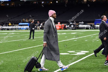 Arizona Cardinals quarterback Brett Hundley arrives before an NFL football game against the New Orleans Saints in New Orleans, . before an NFL football game in New Orleans, Sunday, Oct. 27, 2019