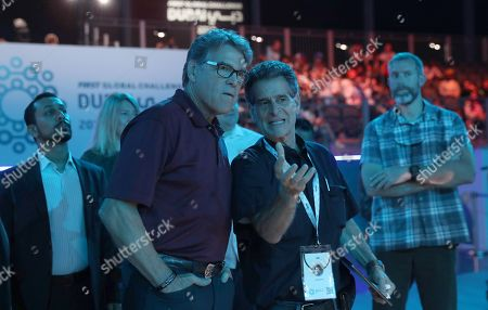 Outgoing US energy Secretary Rick Perry (L) speaks with Dean Kamen, Organizer of First Global at the First Global Challenge Dubai 2019 Robotics competition at the Festival Arena in Dubai, UAE, 27 October 2019. According to media reports on 17 October, US Energy Secretary Rick Perry informed US President Donald Trump that he will resign from his post at the end of the year. Perry is facing increased scrutiny due to the impeachment inquiry concerning the Trump administration's alleged abuse of power amid allegations of pressuring Ukraine to investigate political rival Joe Biden.