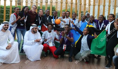 Outgoing US energy Secretary Rick Perry (3-L, standing) poses for photo with students from Africa at the First Global Challenge Dubai 2019 Robotics competition at the Festival Arena in Dubai, UAE, 27 October 2019. According to media reports on 17 October, US Energy Secretary Rick Perry informed US President Donald Trump that he will resign from his post at the end of the year. Perry is facing increased scrutiny due to the impeachment inquiry concerning the Trump administration's alleged abuse of power amid allegations of pressuring Ukraine to investigate political rival Joe Biden.