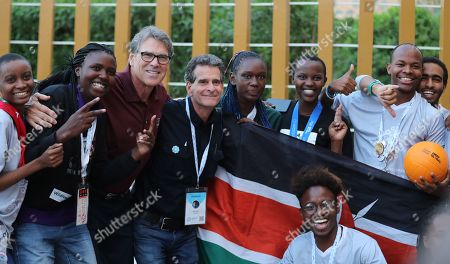 Outgoing US energy Secretary Rick Perry (3-L) poses for photo with students from Africa at the First Global Challenge Dubai 2019 Robotics competition at the Festival Arena in Dubai, UAE, 27 October 2019. According to media reports on 17 October, US Energy Secretary Rick Perry informed US President Donald Trump that he will resign from his post at the end of the year. Perry is facing increased scrutiny due to the impeachment inquiry concerning the Trump administration's alleged abuse of power amid allegations of pressuring Ukraine to investigate political rival Joe Biden.