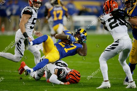 Stock Image of Los Angeles Rams running back Darrell Henderson (27) is tackled by Cincinnati Bengals free safety Jessie Bates III during the first half of an NFL football game, at Wembley Stadium in London