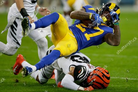 Stock Photo of Los Angeles Rams running back Darrell Henderson (27) is tackled by Cincinnati Bengals free safety Jessie Bates III during the first half of an NFL football game, at Wembley Stadium in London