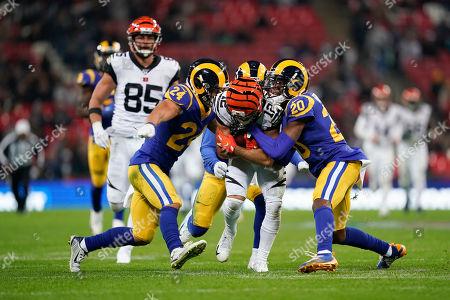 Cincinnati Bengals Wide receiver Alex Erickson (12) is tackled by LA Rams Defensive back Taylor Rapp (24) and LA Rams Defensive back Jalen Ramsey (20) during the International Series match between Los Angeles Rams and Cincinnati Bengals at Wembley Stadium, London