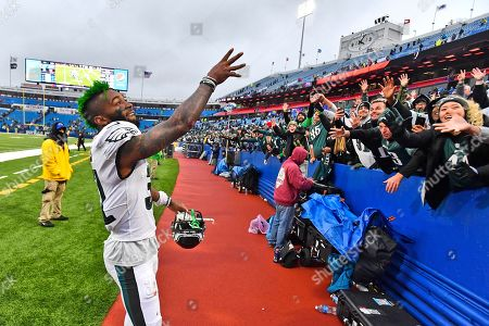 Philadelphia Eagles' Jalen Mills celebrates with fans after an NFL football game, in Orchard Park, N.Y. The Eagles defeated the Bills 31-13