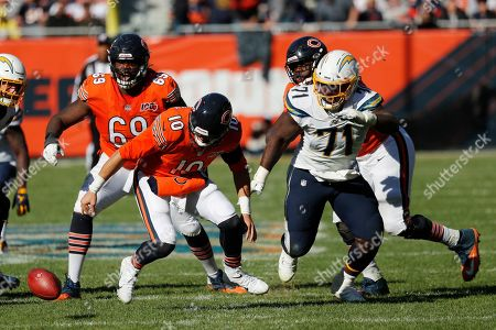 A.J. Klein. Chicago Bears quarterback Mitchell Trubisky (10) fumbles the ball in front of Los Angeles Chargers defensive end Damion Square (71) during the second half of an NFL football game, in Chicago