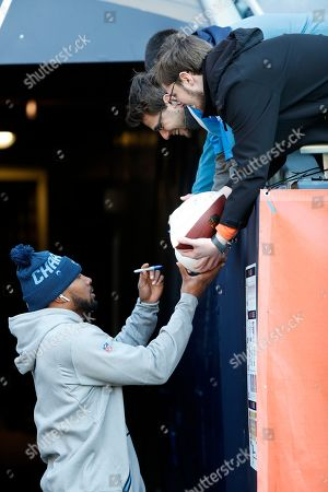 A.J. Klein. Los Angeles Chargers wide receiver Jason Moore signs an autograph for a fan before an NFL football game against the Chicago Bears, in Chicago