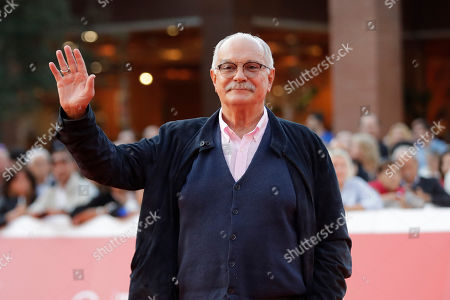 """Director Nikita Mikhalkov poses on the red carpet as he arrives at the presentation of the movie """"The Sin"""" at the 14th edition of the Rome Film Festival"""