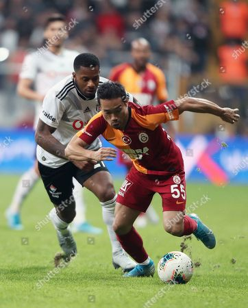 Galatasaray's Yuto Nagatomo (R) in action against Besiktas' Jeremain Lens (L) during the Turkish Super League soccer match between Besiktas and Galatasaray in Istanbul, Turkey, 27 October 2019.