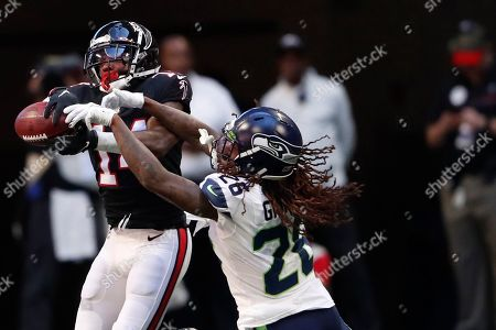 Atlanta Falcons wide receiver Justin Hardy (14) makes the catch against Seattle Seahawks cornerback Shaquill Griffin (26) during the first half of an NFL football game, in Atlanta