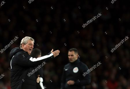 Crystal Palace's manager Roy Hodgson gives instructions to his players during the English Premier League soccer match between Arsenal and Crystal Palace at the Emirates stadium in London