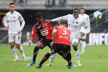 Stock Picture of Yaya Sanogo of Toulouse challenges for the ball with Rennes' Eduardo Camavinga during the League One soccer match between Rennes and Toulouse, at the Roazhon Park stadium in Rennes, France