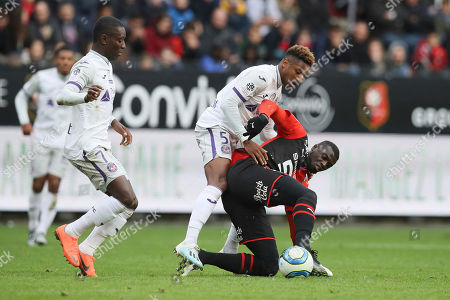 Rennes' forward Mbaye Niang challenges for the ball with Toulouse's Steven Moreira during the League One soccer match between Rennes and Toulouse, at the Roazhon Park stadium in Rennes, France