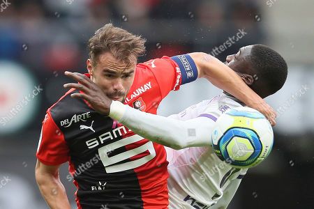 Rennes' Damien Da Silva jumps for a header with Yaya Sanogo of Toulouse during the League One soccer match between Rennes and Toulouse, at the Roazhon Park stadium in Rennes, France