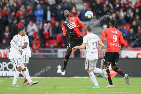 Rennes' forxard Mbaye Niang jumps for the ball during the League One soccer match between Rennes and Toulouse, at the Roazhon Park stadium in Rennes, France