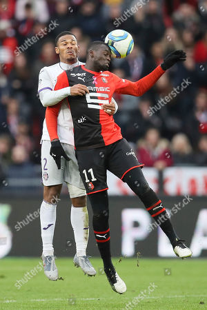 Rennes' forward Mbaye Niang jumps for a header with Kelvin Amian of Toulouse during the League One soccer match between Rennes and Toulouse, at the Roazhon Park stadium in Rennes, France