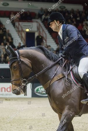 Stock Picture of Robert Whitaker with horse Catwalk IV  competes in the Longines Fei Jumping competition World Cup Helsinki International Horse Show in Helsinki, Finland, 27 October 2019.