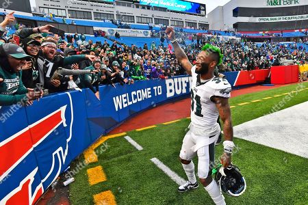 Philadelphia Eagles' Jalen Mills celebrates with fans after an NFL football game against the Buffalo Bills, in Orchard Park, N.Y