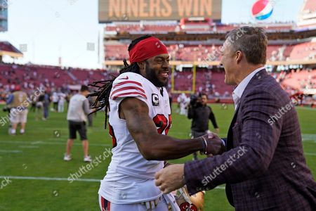 San Francisco 49ers cornerback Richard Sherman is greeted by general manager John Lynch, right, after an NFL football game in Santa Clara, Calif., . San Francisco won the game, 51-13