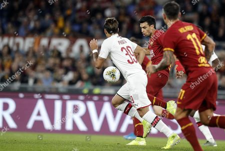 Romas Javier Pastore (R) in action during the Serie A soccer match between AS Roma and AC Milan at the Olimpico stadium in Rome, Italy, 27 October 2019.