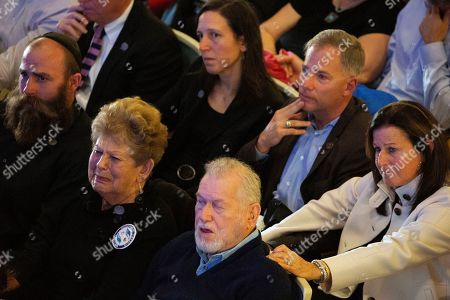 Members of the Rosenthal family and others watch a video remembrance for the victims of the Tree of Life synagogue attack during the one-year commemoration at Soldiers & Sailors Memorial Hall and Museum, in Pittsburgh. Brothers Cecil and David Rosenthal were among those killed in the attack
