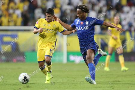 Al-Hilal player Cuella (R) in action for the ball with Al-Nassr player Yahya Al Shehri (L) during the Saudi Professional League soccer match between Al-Hilal and Al-Nassr at King Saud University Stadium in Riyadh, Saudi Arabia, 27 October 2019.