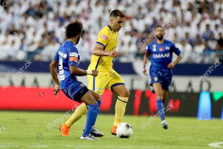 Al-Hilal player Yasser Al Shahrani (L) in action for the ball with Al-Nassr player Abderazak Hamdallah (R) during the Saudi Professional League soccer match between Al-Hilal and Al-Nassr at King Saud University Stadium in Riyadh, Saudi Arabia, 27 October 2019.