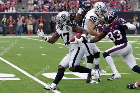 Dwayne Harris, back A.J. Moore. Oakland Raiders wide receiver Dwayne Harris (17) runs past Houston Texans defensive back A.J. Moore (33) during the first half of an NFL football game, in Houston