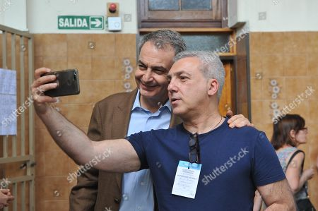 Former President of the Spanish Government Jose Luis Rodriguez Zapatero poses for a picture with an Argentine citizen in a polling station in Buenos Aires, Argentina, 27 October 2019. Rodriguez Zapatero was invited to observe the election day at the invitation of the Frente de Todos, a coalition to which the Alberto Fernandez - Cristina Fernandez de Kirchner belongs. About 33.8 million Argentines go to the polls to elect president and vice president for a four-year term and to partially renew Parliament.