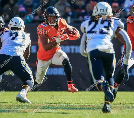 Chicago Bears running back David Montgomery (C) runs against Los Angeles Chargers defensive end Damion Square (L) and Los Angeles Chargers defensive back Rayshawn Jenkins (R) during the NFL game between the Los Angeles Chargers and the Chicago Bears at Soldier Field in Chicago, Illinois, USA, 27 October 2019. The Chargers defeated the Bears.