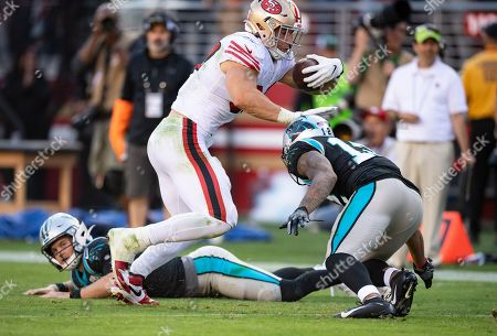 San Francisco 49ers defensive linebacker Nick Bosa (97) gets pressure from Carolina Panthers wide receiver D.J. Moore (12) after making an interception, during a NFL game between the Carolina Panthers and the San Francisco 49ers at the Levi's Stadium in Santa Clara, California