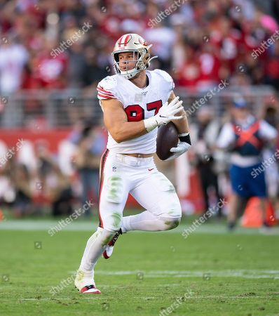 San Francisco 49ers defensive linebacker Nick Bosa (97) gains yards after making an interception, during a NFL game between the Carolina Panthers and the San Francisco 49ers at the Levi's Stadium in Santa Clara, California