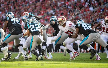 San Francisco 49ers defensive linebacker Arik Armstead (91) goes after Carolina Panthers running back Christian McCaffrey (22), during a NFL game between the Carolina Panthers and the San Francisco 49ers at the Levi's Stadium in Santa Clara, California